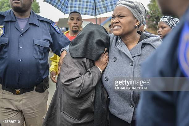 The mother of the suspect accused of Bafana Bafana captain Senzo Meyiwa'murder leaves the Boksburg magistrate court on November 11 2014 in...