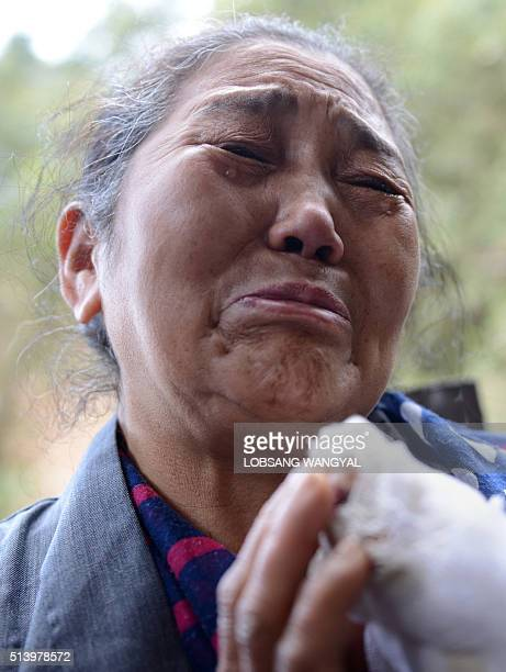 The mother of Tibetan schoolboy Dorje Tsering Nyima Yangzom weeps as his body is cremated in the Indian town of McLeod Ganj on March 6 2016 Hundreds...