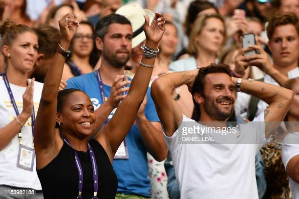 The mother of US player Cori Gauff Candi Gauff and her French tennis coach JeanChristophe Faurel celebrate after Gauff beat Slovenia's Polona Hercog...