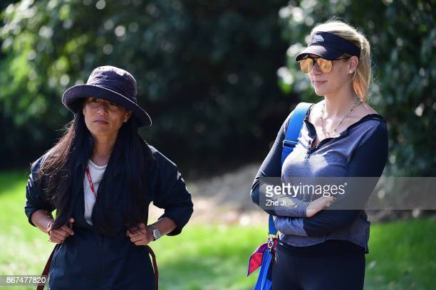 The mother of Xander Schauffele of the United States and Kelley Cahill girlfriend of Jon Rahm of Spain watch on the 17th hole during the first round...