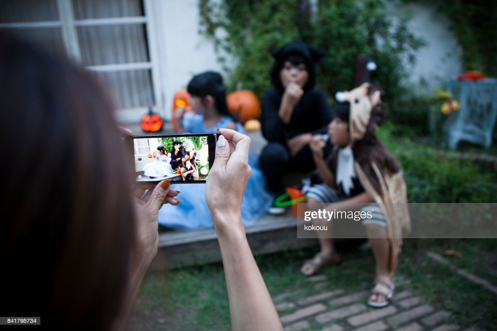 The mother takes pictures of the children. : Stock Photo