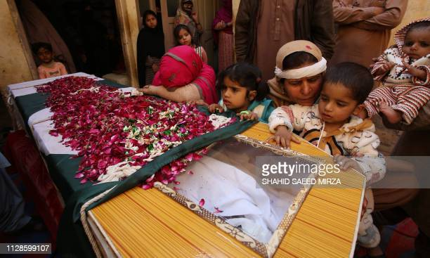 The mother wife and children of Pakistani soldier Khurram Ali who was killed in a gunfight between Indian and Pakistan troops on the Line of Control...
