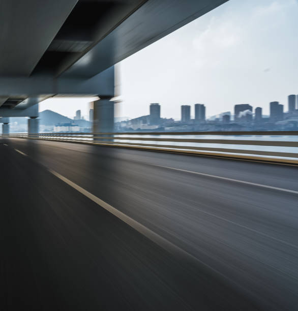 The motion blurred road surface of the bridge photographed on the driving car