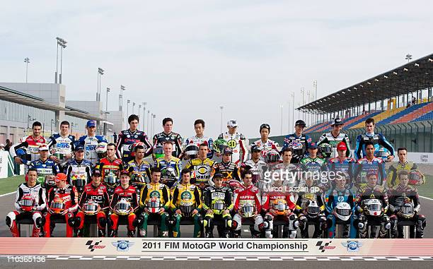 The Moto2 riders pose on the starting grid before the free practice of Doha GP at Losail Circuit on March 17, 2011 in Doha, Qatar.