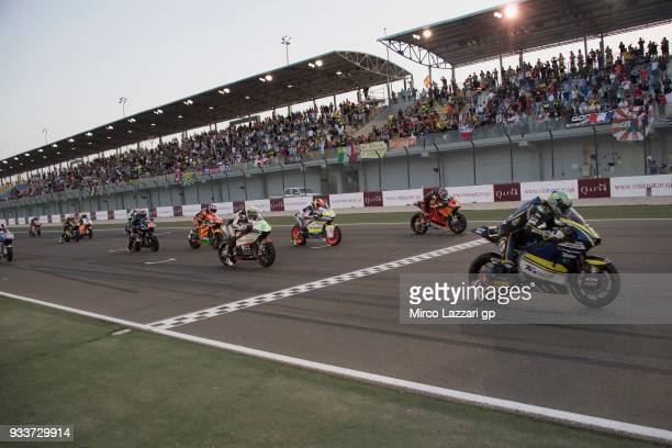 The Moto2 riders prepares to start on the grid during the Moto2 race during the MotoGP of Qatar Race at Losail Circuit on March 18 2018 in Doha Qatar