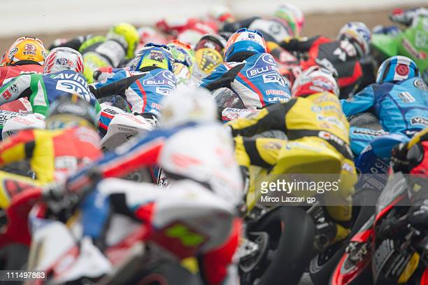 The Moto2 riders round the bend of the first corner during the first lap of the Moto2 race at Circuito de Jerez on April 3, 2011 in Jerez de la...