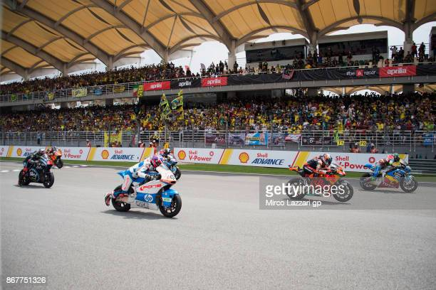 The Moto2 riders start from the grid during the Moto2 race during the MotoGP Of Malaysia Race at Sepang Circuit on October 29 2017 in Kuala Lumpur...