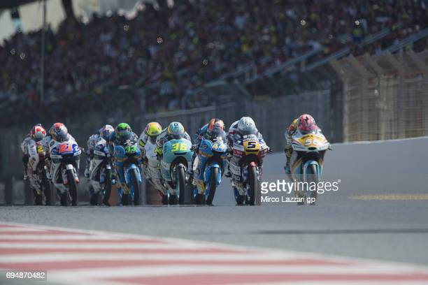 The Moto3 riders start from the grid during the Moto3 race during the MotoGp of Catalunya Race at Circuit de Catalunya on June 11 2017 in Montmelo...