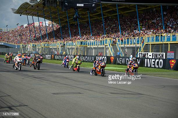 The Moto3 riders start from the grid during the Moto3 race of the MotoGp Of Holland at TT Circuit Assen on June 30 2012 in Assen Netherlands