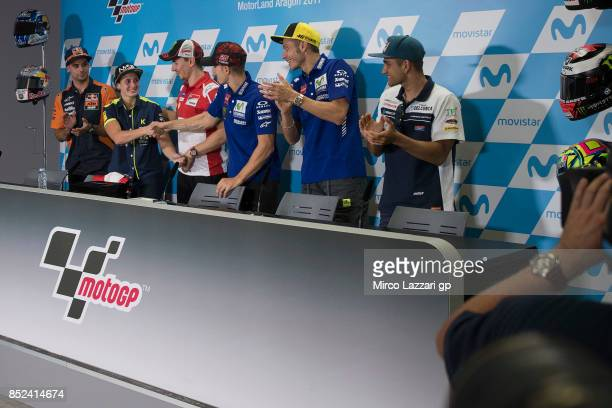 The MotoGP riders celebrate Ana Carrasco of Spain during the press conference at the end of the qualifying practice during the MotoGP of Aragon...