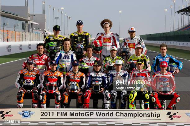The MotoGP riders pose on the starting grid before the free practice of Doha GP at Losail Circuit on March 17, 2011 in Doha, Qatar.