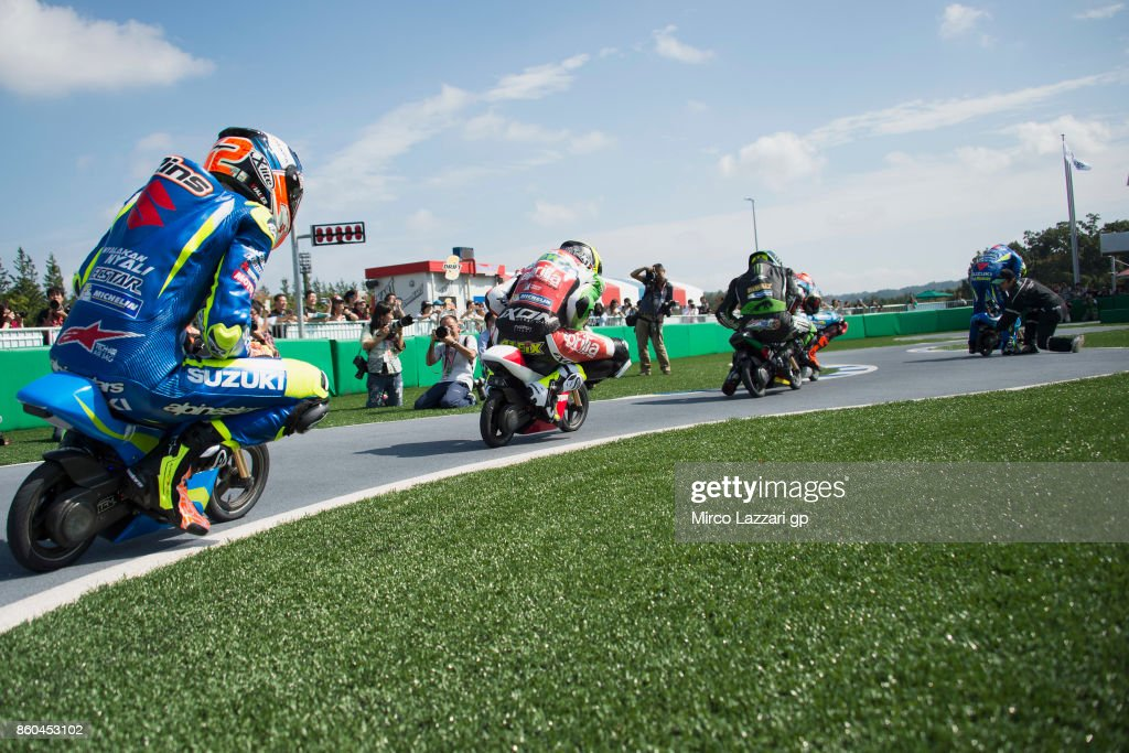 The MotoGP riders ride the mini bikes during the pre-event 'The mini-battle between the MotoGP riders and children with electric mini bikes at Mobi Park at Motegi' ahead of the MotoGP of Japan at Twin Ring Motegi on October 12, 2017 in Motegi, Japan.