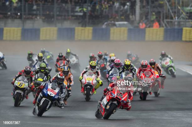 The MotoGP riders round the bend during the first lap of the MotoGP race during the MotoGp Of France Race on May 19 2013 in Le Mans France