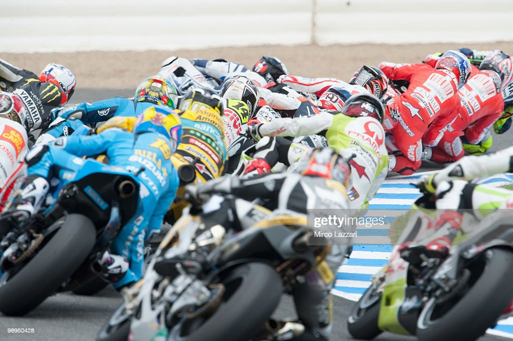 The MotoGP riders rounds the bend at the first corner of first lap during the MotoGP race at Circuito de Jerez on May 2, 2010 in Jerez de la Frontera, Spain.