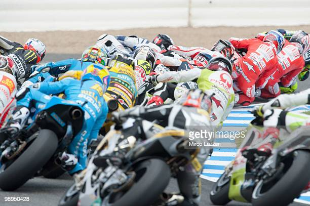 The MotoGP riders rounds the bend at the first corner of first lap during the MotoGP race at Circuito de Jerez on May 2 2010 in Jerez de la Frontera...