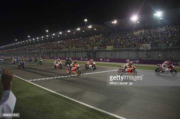 The MotoGP riders start from the grid during the MotoGP race during the MotoGp of Qatar Race at Losail Circuit on March 29 2015 in Doha Qatar