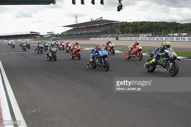 The MotoGP riders start from the grid during the MotoGP race during the MotoGp Of Great Britain Race at Silverstone Circuit on September 4 2016 in...