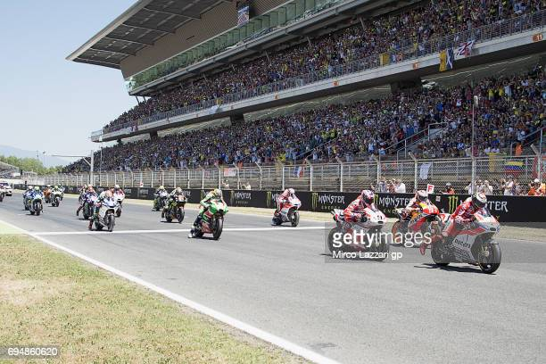 The MotoGP riders start from the grid during the MotoGP race during the MotoGp of Catalunya Race at Circuit de Catalunya on June 11 2017 in Montmelo...