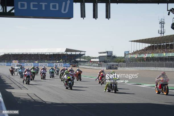 The MotoGP riders start from the grid during the MotoGP race during the MotoGp Of Great Britain Race at Silverstone Circuit on August 27 2017 in...