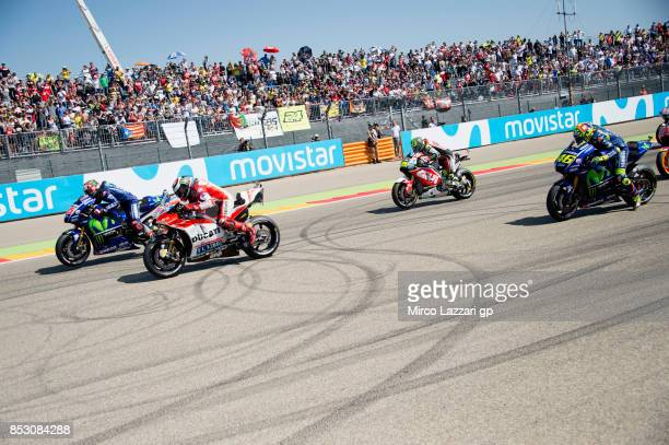 The MotoGP riders start from the grid during the MotoGP race during the MotoGP of Aragon Race at Motorland Aragon Circuit on September 24 2017 in...