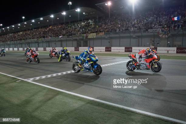 The MotoGP riders start from the grid during the MotoGP race during the MotoGP of Qatar Race at Losail Circuit on March 18 2018 in Doha Qatar