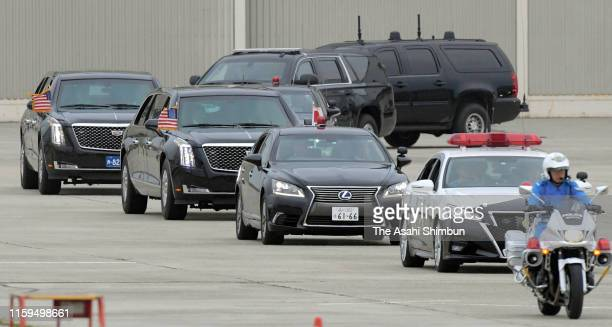The motorcade carrying U.S. President Donald Trump arrives after the second day of the G20 summit at Osaka International Airport on June 29, 2019 in...
