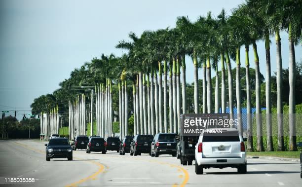 The motorcade carrying US President Donald Trump is seen near the Trump International Golf Club West Palm Beach in West Palm Beach Florida on...