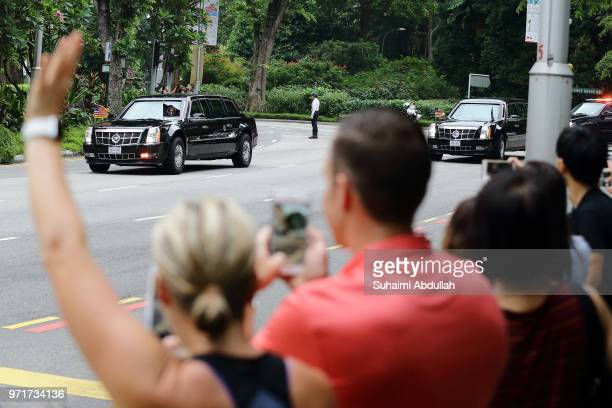The motorcade carrying US President Donald Trump leaves for Capella Hotel on June 12 2018 in Singapore The historic meeting between US President...