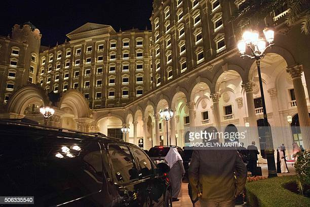 The motorcade carrying US Secretary of State John Kerry arrives at the RitzCarlton Hotel early in the morning in Riyadh on January 23 after a...