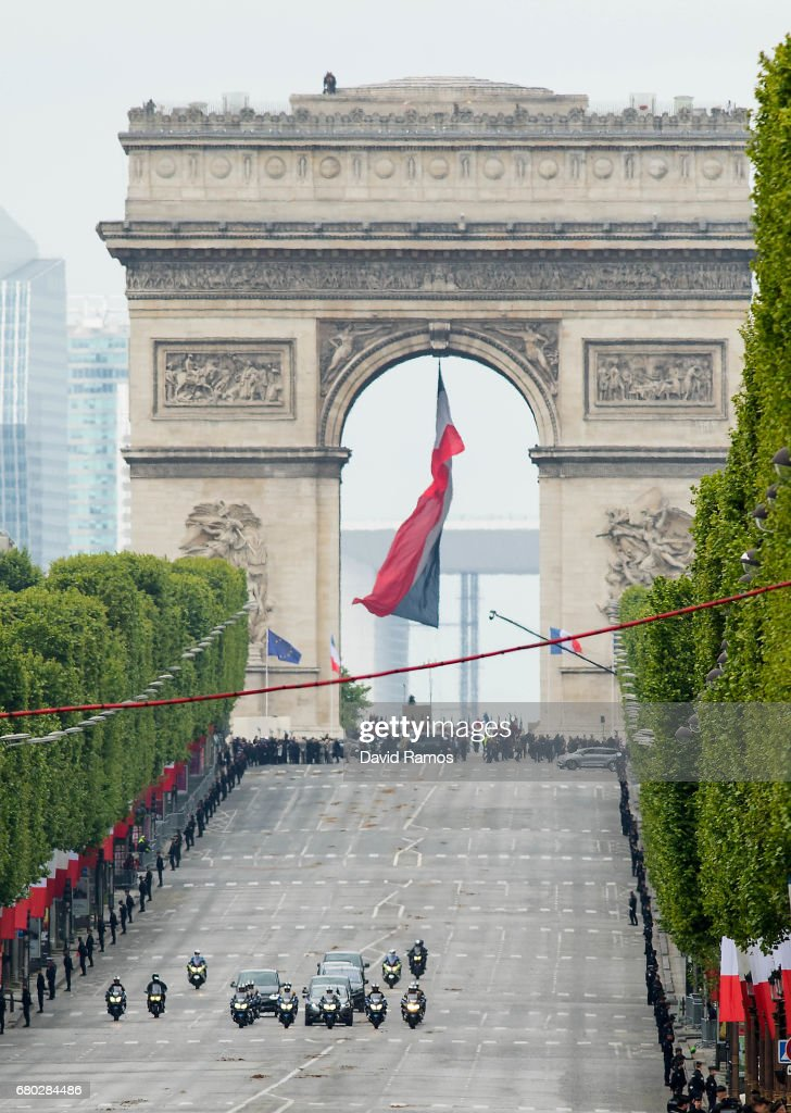 The motorcade of French president-elect Emmanuel Macron and outoing president Francois Hollande drives down the Champs Elysse after attending the ceremony to mark Western allies' World War Two victory in Europe on May 8, 2017 in Paris, France. The ceremony marks the 72nd anniversary of the victory over Nazi Germany in 1945.