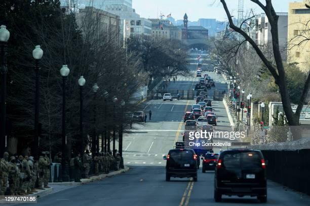 The motorcade of President Joe Biden drives towards Arlington National Cemetery following his inauguration on January 20, 2021 in Washington, DC.