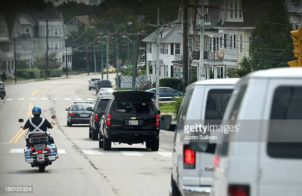 The motorcade of Republican presidential candidate and former Massachusetts Gov. Mitt Romney drives towards Downtown Boston on August 10, 2012 in...
