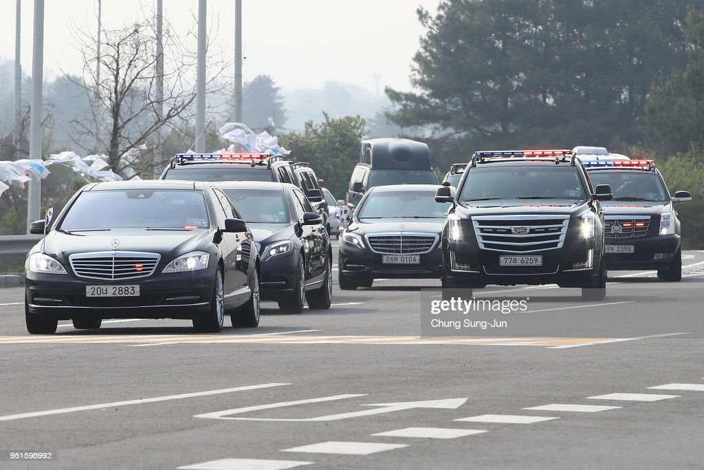 The motorcade of South Korean President Moon Jae-In drive past a checkpoint on the road connecting South and North Korea at the Unification Bridge, near the Demilitarized zone (DMZ) separating South and North Korea on April 27, 2018 in Paju, South Korea. North Korean leader Kim Jong Un and South Korean President Moon Jae-in were scheduled to meet at the border today for the third-ever inter-Korean summit talks since the 1945 division of the peninsula.