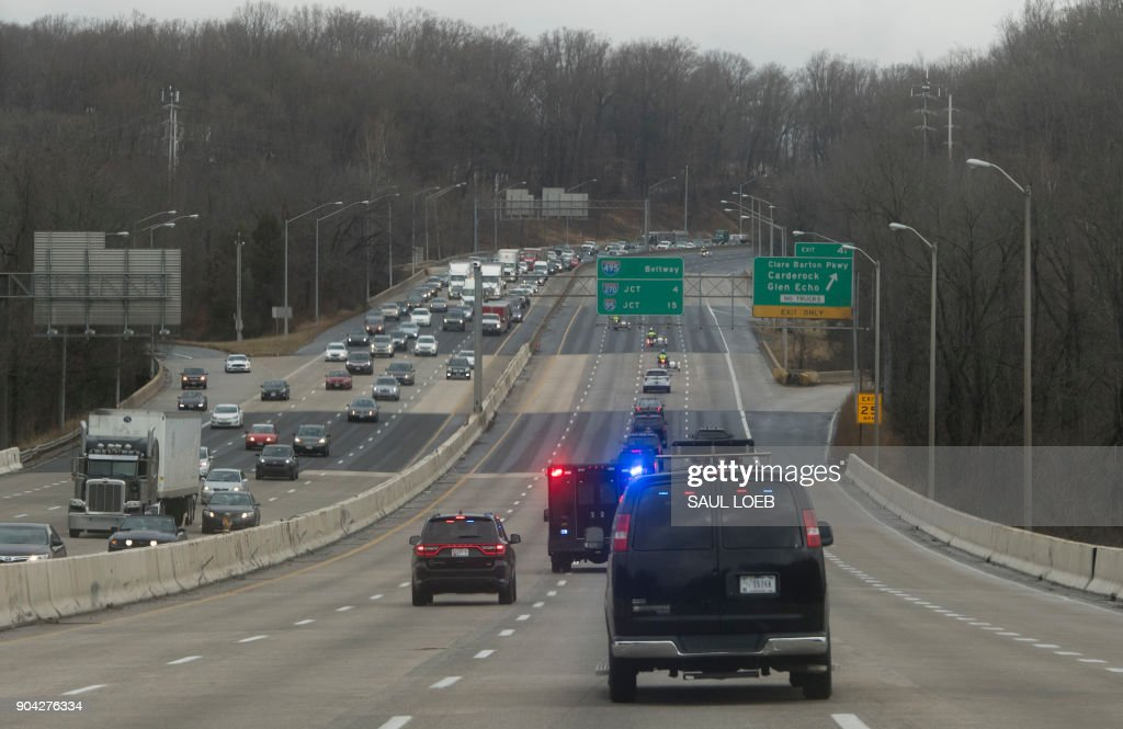 The motorcade of US President Donald Trump drives on the Washington Beltway as he travels to Walter Reed National Military Medical Center for his annual physical in Bethesda, Maryland, January 12, 2018. /