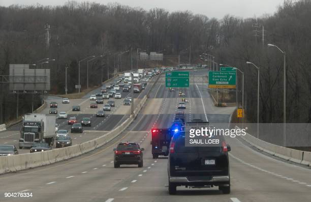 The motorcade of US President Donald Trump drives on the Washington Beltway as he travels to Walter Reed National Military Medical Center for his...