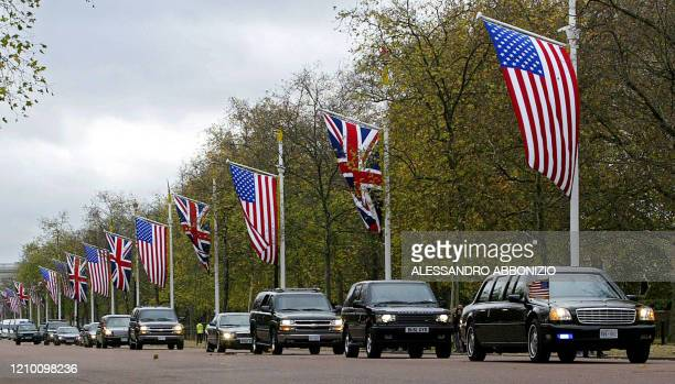 The motorcade of US President George W. Bush passes down the Mall on the way to the US Embassy in London 18 November, 2003. AFP PHOTO/ALESSANDRO...