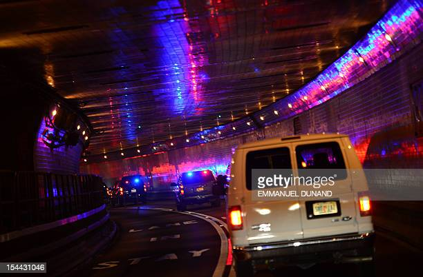 The motorcade of US Republican presidential candidate Mitt Romney leaves New York by the Lincoln Tunnel in New York October 19 2012 AFP...