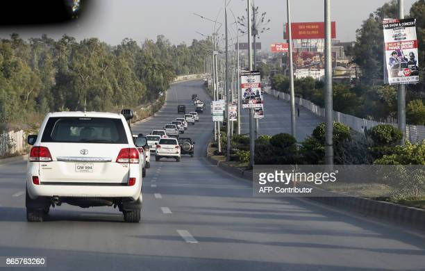The motorcade of US Secretary of State Rex Tillerson makes its way to the US embassy in Islamabad on October 24 2017 Tillerson landed in Islamabad on...