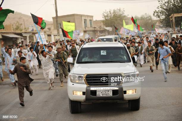 The motorcade transporting Afghanistan's former foreign affairs minister and presidential election candidate Abdullah Abdullah arrives in Pule Khumri...