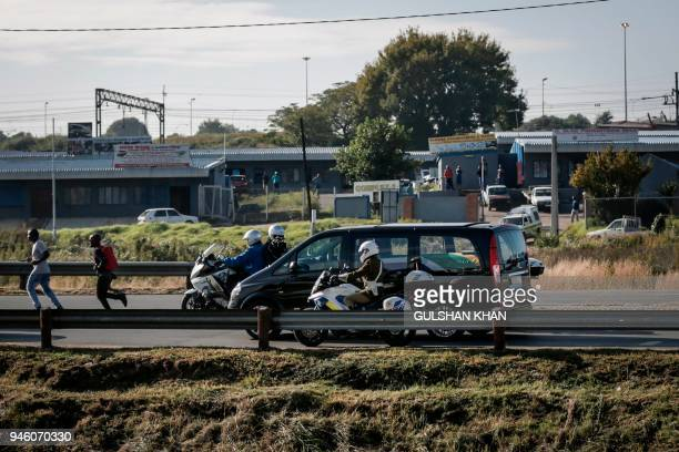 The motorcade transporting the coffin of Winnie Madikizela-Mandela drives through Soweto after leaving her home towards Orlando Stadium for a funeral...