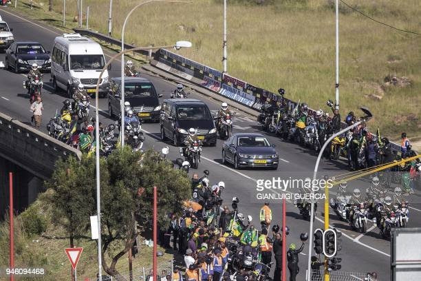 The motorcade transporting the coffin of Winnie MadikizelaMandela drives through Soweto after leaving her home towards Orlando Stadium for a funeral...