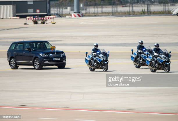 The motorcade with Britain's Queen Elizabeth II and Prince Philip departs from the airport in Frankfurt/MainGermany 25 June 2015 The Queen and her...
