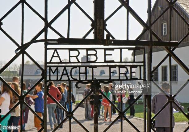 The motto 'Arbeit macht frei' built in to the ironwork of the gateway of the Jourhaus the SS guardroom and transit building at the site of the former...