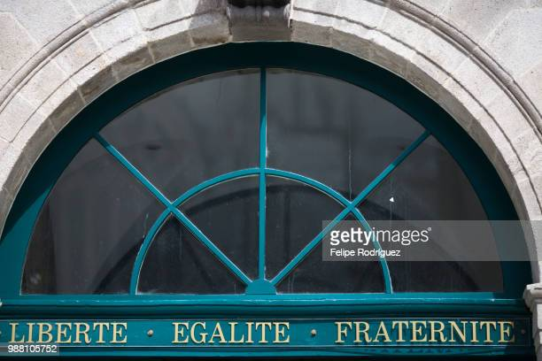 The motto 'Liberte, Egalite, Fraternite' on the door of the City Hall, town of Quimper, departament