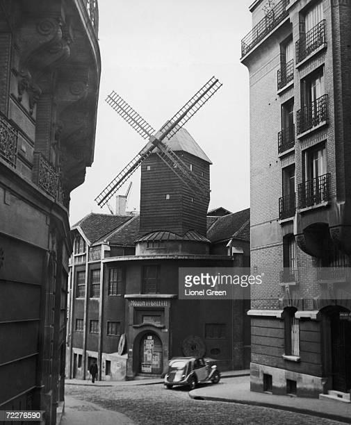 The Moulin de la Galette in the Montmartre district of Paris circa 1935