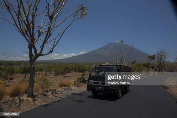 The Mount Agung is seen as Indonesians leave the dangerzone due to the volcanic activities of Mount Agung in Karangasem Regency Bali Indonesia on...