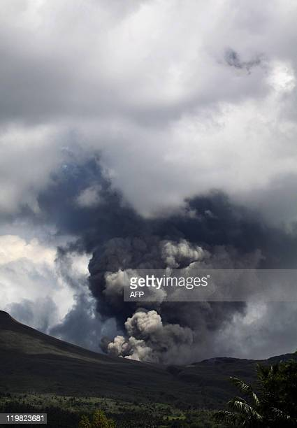 The Mount Lokon volcano spews thick smoke and ash into the air in Tomohon on the northeastern part of Indonesia's Sulawesi island on July 17, 2011....
