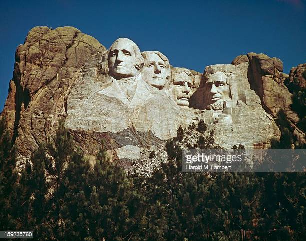 The Mount Rushmore National Memorial in South Dakota USA featuring the carved stone faces of US Presidents George Washington Thomas Jefferson...
