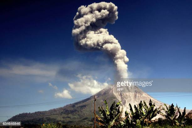 The Mount Sinabung volcano spews smoke and ash as seen from Karo district in North Sumatra province on February 11 2017 Activity levels have...