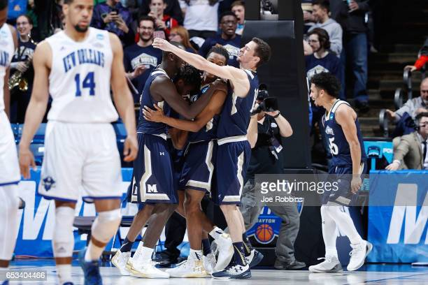 The Mount St Mary's Mountaineers celebrate defeating the New Orleans Privateers 6766 in the First Four game during the 2017 NCAA Men's Basketball...